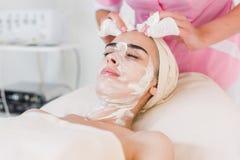 Facial mask removing at beauty salon Stock Photography