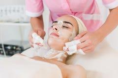 Facial mask removing at beauty salon Stock Images