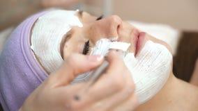 Facial mask at spa salon stock footage