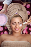 Facial mask treatment. Of charming woman in spa salon Royalty Free Stock Photography