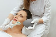 Facial Mask. Woman Applying Cosmetic Alginate Mask On Skin royalty free stock photo
