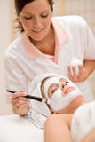 Facial mask - Woman at beauty salon Stock Image