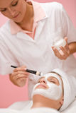 Facial mask - woman at beauty salon Stock Photo