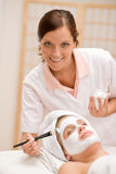 Facial mask - woman at beauty salon Royalty Free Stock Photo
