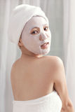 Facial mask for the young lady at spa Royalty Free Stock Photo