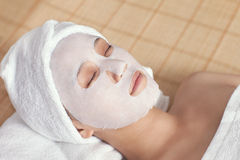 Facial mask for the young lady at spa. At spa salon, Indoors Stock Photos