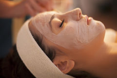 Facial mask. Young woman in spa with facial mask Stock Image