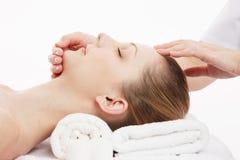 Facial massage. Young Caucasian woman facial massage stock photography
