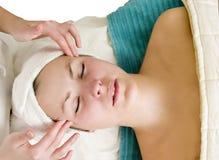 Facial Massage. A woman receiving a facial massage at a beauty spa Royalty Free Stock Photography