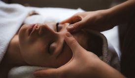 Free Facial Massage At Spa Stock Photo - 138545240