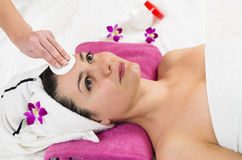 Facial Massage. Attractive young woman getting a facial massage in the beauty spa stock photo
