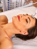 Facial massage at beauty salon. Electric stimulation woman skin care. Royalty Free Stock Photography