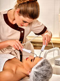 Facial massage at beauty salon. Electric stimulation woman skin care. Royalty Free Stock Photos