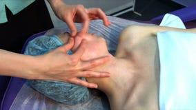 Facial massage closeup stock video