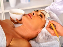 Facial massage for forty five year old woman spa salon. Royalty Free Stock Images