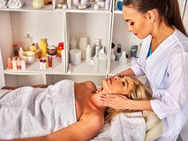 Facial massage for forty five year old woman spa salon. Stock Photography