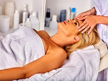 Facial massage for forty year old woman in spa salon. Royalty Free Stock Photos