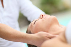Facial massage given to a young woman Stock Image