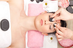 Facial massage with mineral stone Royalty Free Stock Images