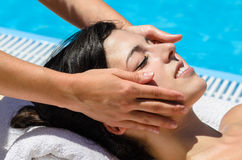 Facial massage at poolside. Relaxing facial massage in spa club at poolside Stock Photos