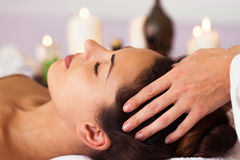 Facial massage. Pretty woman relaxing in the beauty treatment. Stock Images