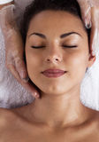 Facial massage. Pretty woman relaxing in the beauty treatment. Royalty Free Stock Photography