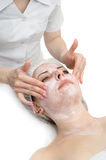 Facial massage with scrub mask Stock Photo