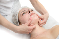 Facial massage with scrub mask Royalty Free Stock Image