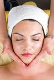 Facial massage at daily spa. Beautiful woman at daily spa receiving a facial massage from a professional beautician,check also Royalty Free Stock Image