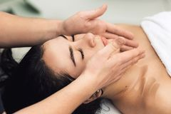 Facial massage in spa. Cosmetology clinic, spa, wellness, health care concept. Facial massage in spa. Cosmetology clinic, spa, wellness, health care concept stock photo