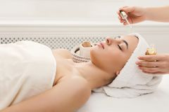 Woman getting professional facial massage at spa salon. Facial massage. Spa, resort, beauty and health concept. Beautiful woman getting professional face royalty free stock photography
