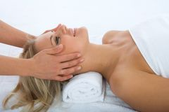 Facial massage to the girl stock photography