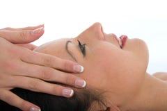 Facial massage to the girl stock photos