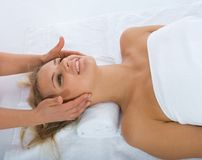 Facial massage to the girl Royalty Free Stock Photos