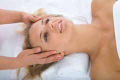 Facial massage to the girl Stock Photos