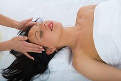 Facial massage to the girl royalty free stock photo