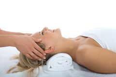 Facial massage to the girl Royalty Free Stock Image