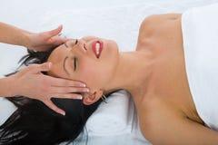 Facial massage to the girl royalty free stock photos