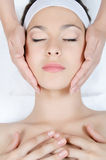 Facial massage to the woman. Close up Stock Image