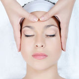 Facial massage to the woman Royalty Free Stock Photography