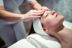 Facial massage treatment by professional Royalty Free Stock Photo