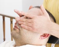 Facial massage for man in barber shop in Turkey royalty free stock images