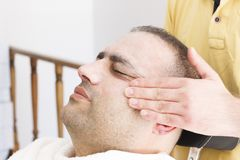 Facial massage for man in barber shop in Turkey royalty free stock image