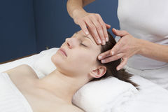 Facial massage for welbeing and rejuvenation. Soothing ayurveda treatment at the spa stock photo