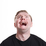 Facial negative expressions. Shouting man looking up, isolated on white background Royalty Free Stock Photo
