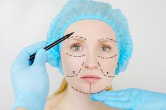 Facial plastic surgery or facelift, facelift, face correction. A plastic surgeon examines a patient before plastic surgery royalty free stock photography