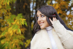 Facial portrait of a beautiful arab woman warmly clothed outdoor Royalty Free Stock Photo