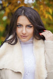 Facial portrait of a beautiful arab woman warmly clothed outdoor Royalty Free Stock Images