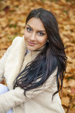 Facial portrait of a beautiful arab woman warmly clothed outdoor Royalty Free Stock Photos