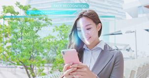 Facial Recognition with smart phone. Asian businesswoman using the facial recognition system with smart phone stock photo